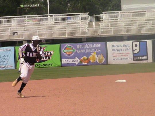 Madison County's Jaebion Mitchell runs towards third