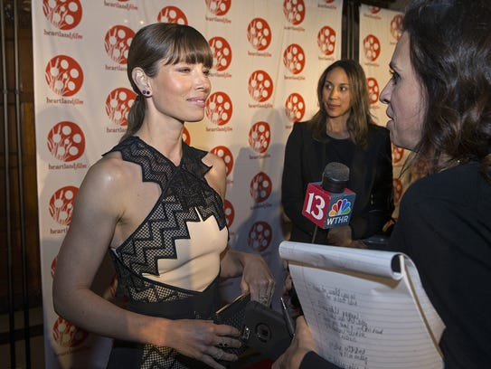 Actress Jessica Biel talks to media on the red carpet