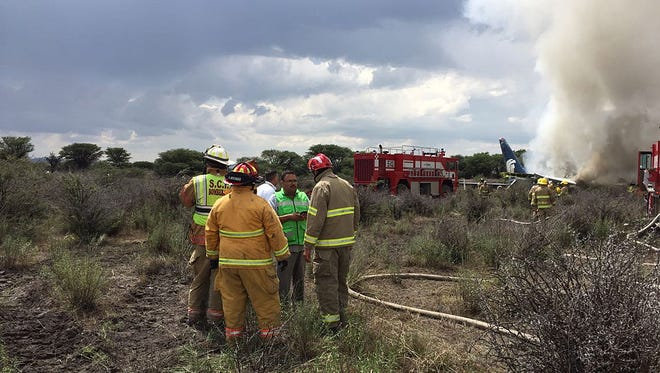 A handout photo made available by the Civil Protection State Coordination (CPCE) shows emergency personnel at the site where an Aeromexico plane crashed, in Durango, Mexico, 31 July 2018. 100 people were reported to be on board. No official casualty report has been released.