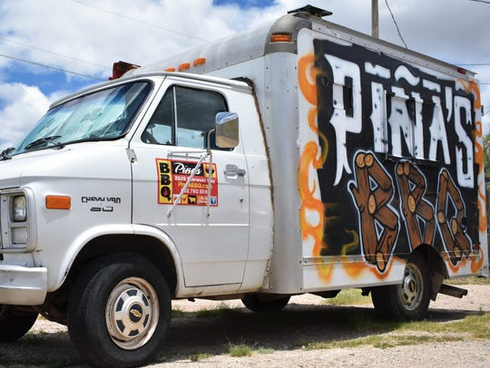 Pina's BBQ food truck sits in the parking lot of Pina's BBQ restaurant June 20, 2018. The restaurant evolved out of the success of the food truck.