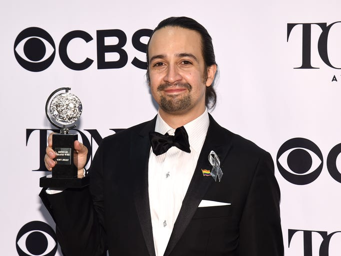 Lin-Manuel Miranda poses in the press room with the
