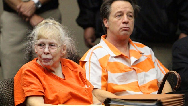 Lisbeth Garrett, left, and her son, Roger Garrett, are shown at a bond hearing in 168th District Court in April 2013.