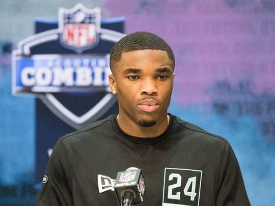 Jeff Okudah answers questions on Friday at the NFL combine.