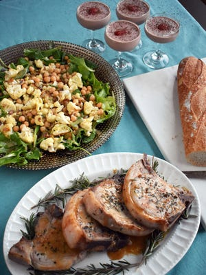 Rosemary pork chops, roasted cauliflower salad, baguettes and chocolate strawberry milkshakes with brandy make a fine meal at home for Valentine's Day.