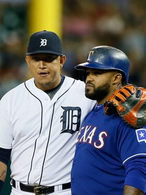Tigers first baseman Miguel Cabrera puts his arm around Rangers DH Prince Fielder's shoulder after Fielder singled to lead off the ninth inning of the Tigers' 2-0 loss Friday at Comerica Park.