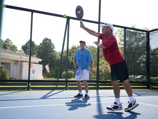 Jim Freeman and Joe Lunczynski play platform tennis