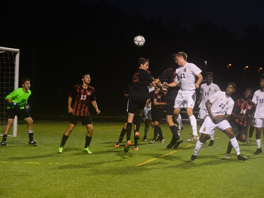 The Bennett Clippers clear out a corner kick opportunity