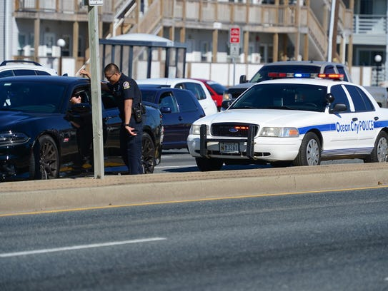 An Ocean City Police Office pulls over a car during