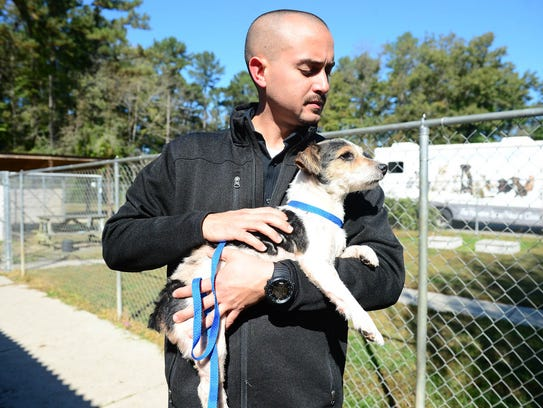 Walter Fenstermacher, Brandywine Valley director of operations holds Gracie, a terrier mix that will be up for adoption after being rescued from an animal hoarding situation in Seaford, Del.
