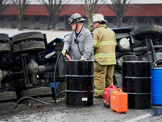 Lebanon County Hazardous Material Response Team responded Wednesday morning to the scene of an over turned semi  on Quentin Rd. In West Cornwall. Emergency personnel pump the fuel from the tractor trailer before uprighting the vehicle.
