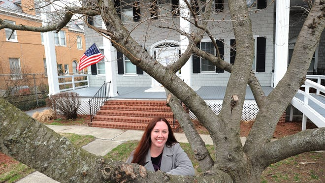 Jessica Finan, executive director of Home of the Brave, stands outside the Home of the Brave's new shelter for homeless female veterans.