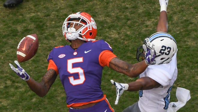Clemson wide receiver Tee Higgins (5) reaches for a pass near The Citadel defensive back Tyus Carter(23) during the second quarter in Memorial Stadium at Clemson on November 18.