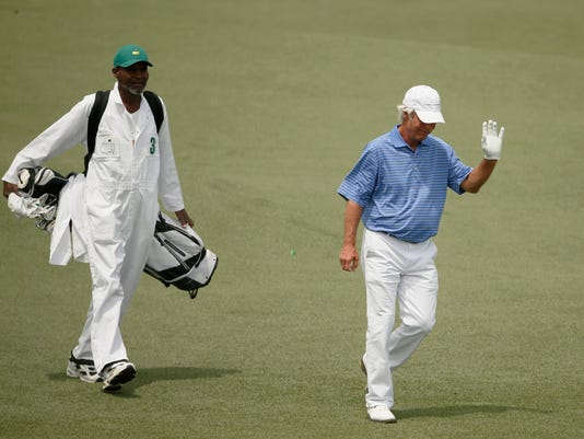 Crenshaw of the U.S. walks up the second fairway with his caddie Jackson during second round play of the Masters golf tournament at the Augusta National Golf Course in Augusta