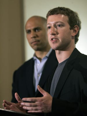 Mark Zuckerberg, right, founder and CEO of Facebook, talks about his donation of $100 million to help Newark public schools during a press conference Sept. 25, 2010, in Newark, N.J.