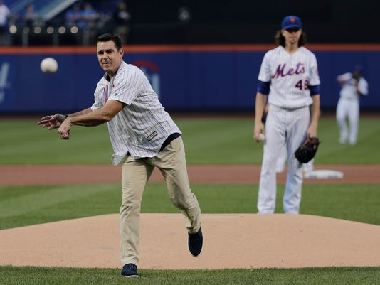 Former Major League Baseball player Billy Bean throws out the first pitch before the start of a baseball game between the New York Mets and the San Diego Padres, Saturday, Aug. 13, 2016, in New York. Bean threw out the pitch on the first Mets Pride Night. (AP Photo/Julie Jacobson)