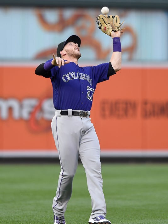 Colorado Rockies shortstop Trevor Story catches a pop up by Baltimore Orioles' Adam Jones during the first inning of a baseball game, Wednesday, July 27, 2016, in Baltimore. (AP Photo/Nick Wass)