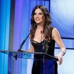 Sandra Bullock accepts the Hollywood actress award at the 17th Annual Hollywood Film Awards Gala at the Beverly Hilton Hotel on Monday, Oct. 21, 2013, in Beverly Hills, Calif. (Photo by Todd Williamson/Invision/AP)