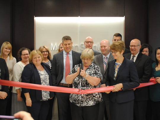 Morgan Stanley employees attend the company's ribbon cutting ceremony.