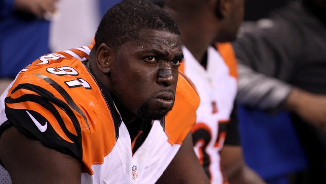 Robert Geathers sits on the bench at the end of the Bengals' playoff loss to the Colts at Lucas Oil Stadium in Indianapolis.