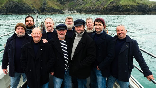 """The actors playing Fisherman's Friends gather for an """"album cover"""" shot."""