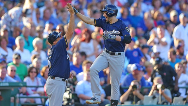 Ryan Braun celebrates his two -run homer with third base coach Ed Sedar during the eighth inning against the Cubs at Wrigley Field.