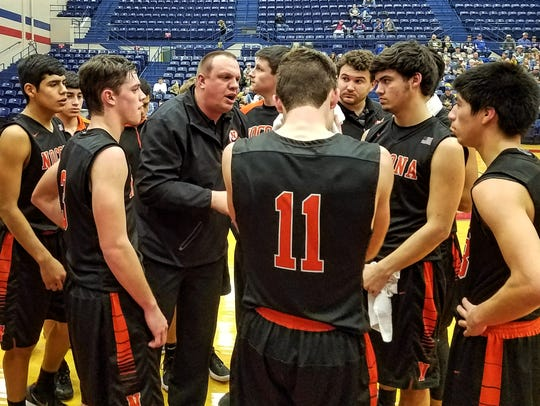 Nocona coach Bret Botard (center) talks to his team