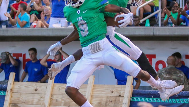 West Florida wide receiver Ka'Ron Ashley (9) celebrates with teammate Rodney Coates after scoring a touchdown against Chowan University in the first home game of the 2017 season at Blue Wahoos Stadium on Saturday, Sept. 16, 2017.