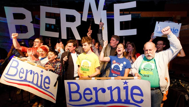 Bernie Sanders supporters react to poll results during the Oregon primary election during a rally in Eugene, Ore. Tuesday May 17, 2016. After Bernie Sanders won Oregon's Democratic primary this week, two superdelegates announced they'll back the Vermont senator while one declared support for Hillary Clinton. The developments come amid increased distaste with a system viewed as undemocratic, even among some of the superdelegates themselves.  (Ryan Kang/The Register-Guard via AP)