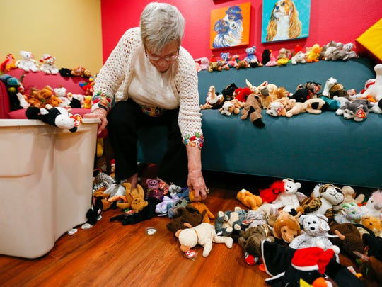Dolores Hulsey, 84, sits on a couch surrounded by Beanie