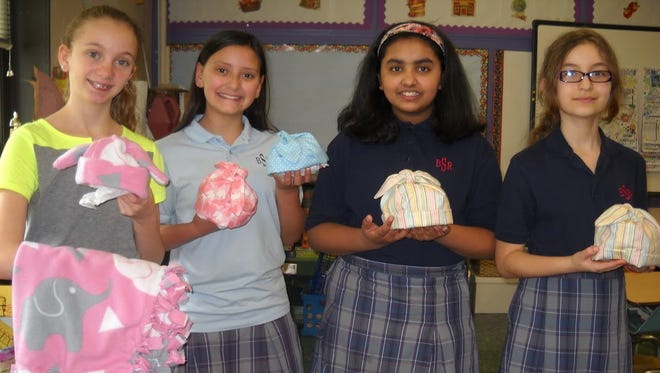 Bishop Schad Regional School's needle craft club knitted hats for newborn babies and delivered them to Inspira Health Network. Jessica Tola, Cassidy Garcia, Shreya Retish, Riley Hudson and Kyleigh Strain are members of the club.