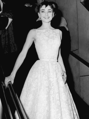Audrey Hepburn, wearing a Givenchy gown, at the 26th Annual Academy Awards at the Pantages Theater in Hollywood, California on March 25, 1954