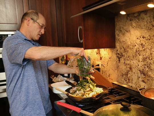 Rick Winter adds greens to his low-carb pad Thai.