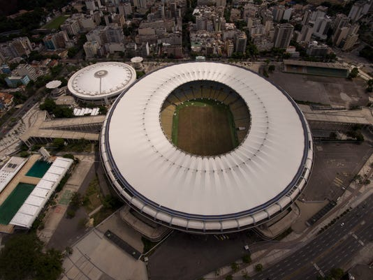 FILE - In this file photo dated Feb. 2, 2017,  the Maracana stadium in Rio de Janeiro, Brazil.   Court testimonies published Wednesday April 12, 2017,  reveal that an investigation of Brazil's biggest constructor found new evidence of possible corruption in the building and financing of half of the 2014 World Cup stadiums, including the Maracana stadium in Rio. (AP Photo/Silvia Izquierdo, FILE)