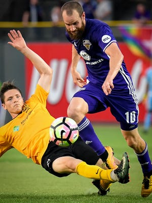 Louisville City's Brian Ownby (10) plays against Pittsburgh Riverhounds Ben Fitzpatrick (21) during their game played in Louisville, June 17, 2017.