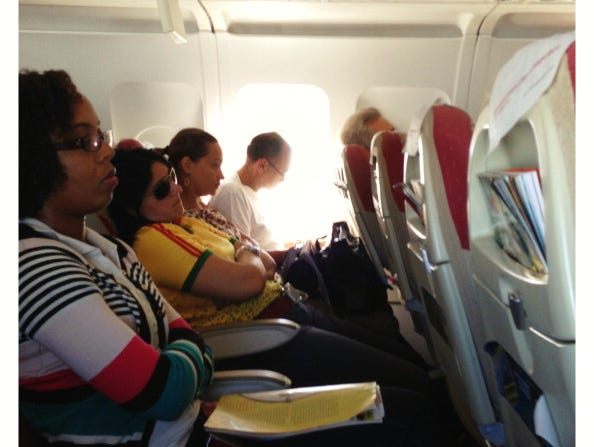 In cramped quarters on a plane, who really wants to hear everyone's cellphone conversations?