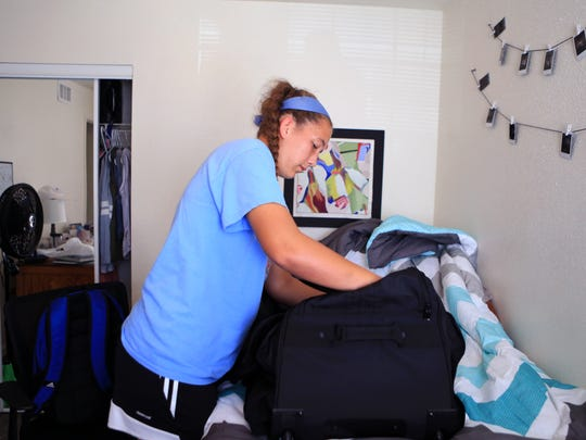 Kyleigh Hall, a member of the Islander soccer team, packs up to leave Texas A&M University-Corpus Christi student housing on Wednesday, August 23, 2017 after the university called for an evacuation as Tropical Depression Harvey headed toward the Gulf of Mexico.