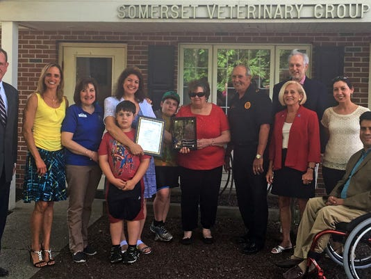 Freeholders join in recognizing local veterinarian