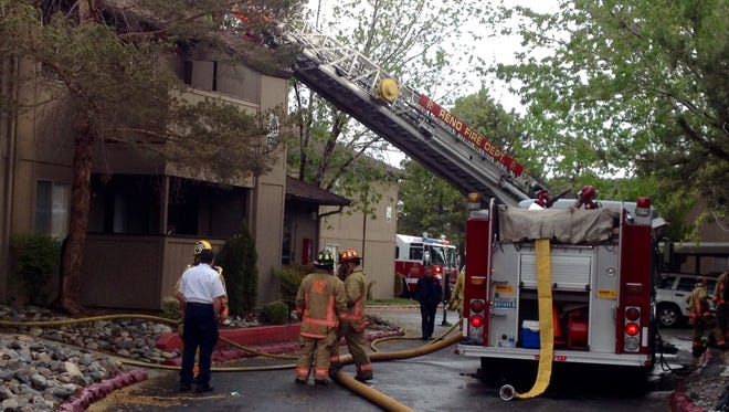 Reno firefighters work the scene of an apartment fire at 4800 Kietzke Lane on Friday, April 24, 2015.