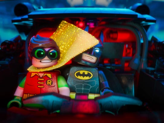 Robin (left, voiced by Michael Cera) and Batman (voiced