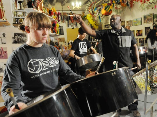 Molly Schneider, 16, and Corey Ciotti, 30, both of Detroit, follow instructions from Lyndon Sorzano at a rehearsal for the Caribbean Pans of Joy's performance in the Marche du Nain Rouge on March 20. The dozen or so players come from all over the spectrum of experience playing the national instrument of Trinidad and Tobago.
