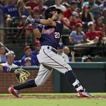 Minnesota Twins left fielder Eddie Rosario (20) hits a home run during the fifth inning against the Texas Rangers at Globe Life Park in Arlington.