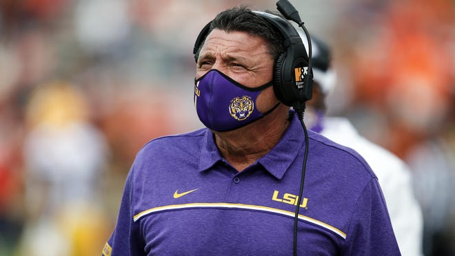 LSU head coach Ed Orgeron walks the sideline during the first quarter of an NCAA college football game against Auburn on Saturday, Oct. 31, 2020, in Auburn, Ala.