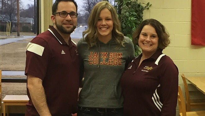 Port Huron High School graduate Brittany Goodwin stands with coaches from Jackson Community College
