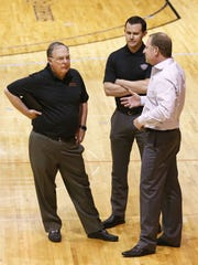 Phoenix Suns' Lon Babby,  Ryan McDonough and  Robert Sarver at a draft workout in 2015.