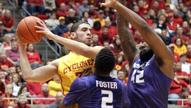 Kansas State Wildcats guard Marcus Foster (2) and Kansas State Wildcats forward Thomas Gipson (42) defend Iowa State Cyclones forward Georges Niang (31) at James H. Hilton Coliseum.