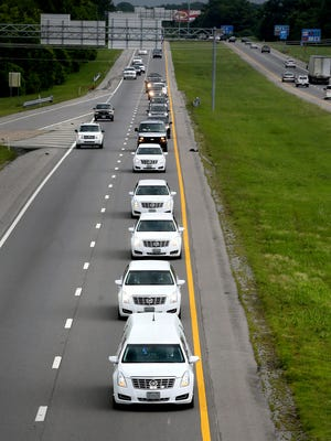 The hearse carrying the body of U.S. Marine Staff Sgt. David Wyatt, is followed by a caravan while traveling on I-24 E in Murfreesboro on Thursday, July 23, 2015. Wyatt's body is being transported back to Chattanooga from Delaware. He will be buried at the Chattanooga National Cemetery.