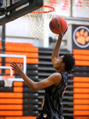 MTCS' Kavan Hill goes up for a shot during practice on Tuesday March 15, 2016.
