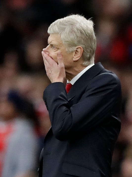 Arsenal's manager Arsene Wenger holds his hand to his face during the English Premier League soccer match between Arsenal and Middlesbrough at the Emirates Stadium in London, Saturday, Oct. 22, 2016. (AP Photo/Matt Dunham)