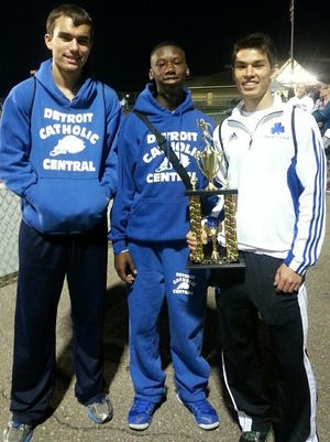 Catholic Central's (from left) Collin Brefka, Tre'Vaughn Jenerette and Connor Canavan hold the runner-up trophy at Observerland Boys Track and Field Relays.