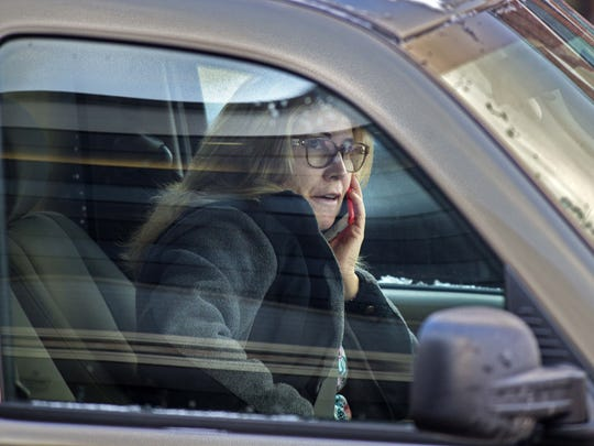 A driver uses a cell phone while stopped at a light in Burlington on Wednesday January 13, 2016.